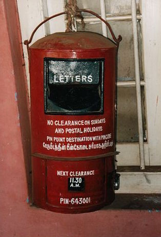 "India Post - Post Box ""Indian Post Box"". Licensed under Public Domain via Wikimedia Commons."