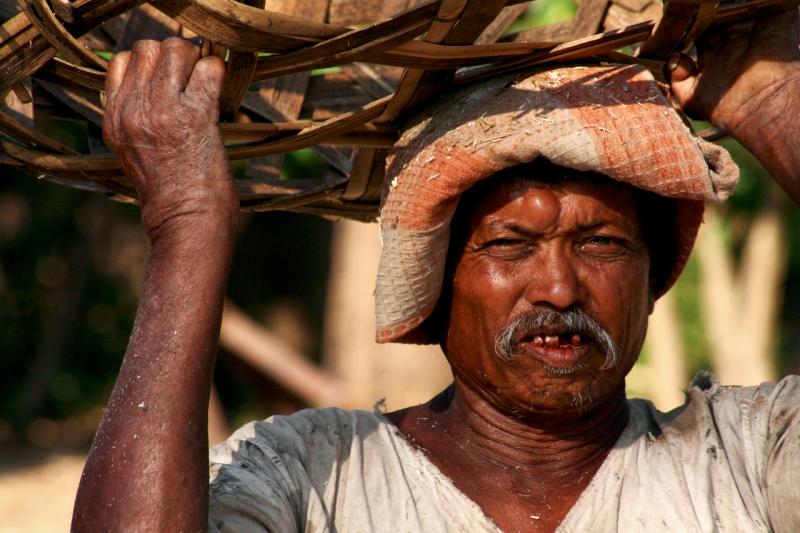 An old man working at a molasses (jaggery) unit, Kolhapur, Mh, India